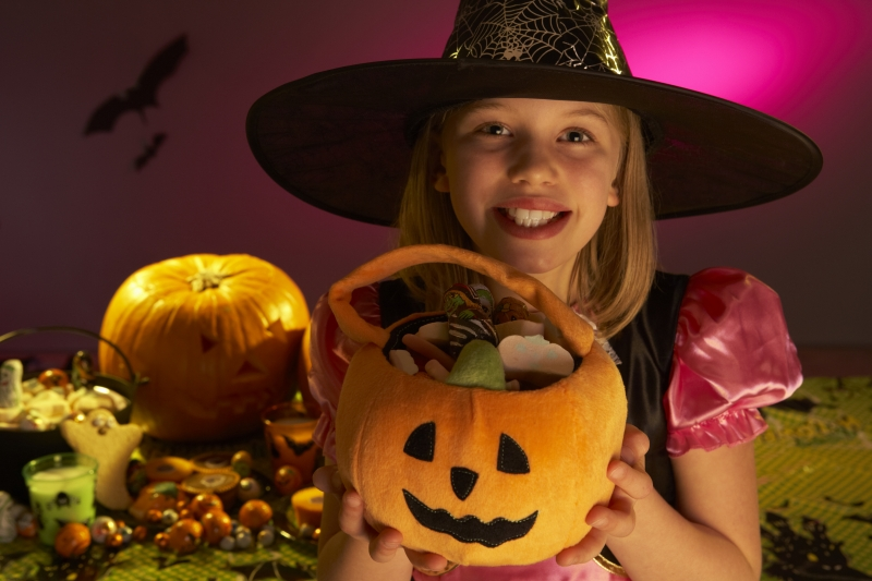 halloween-party-with-a-child-showing-candy